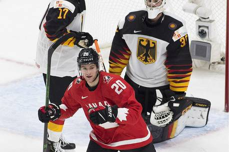 Canada's Dawson Mercer (20) celebrates a goal scored on Germany's goalie  Jonas Gahr (30) during second period IIHF World Junior Hockey Championship action on Saturday, Dec. 26, 2020 in Edmonton.