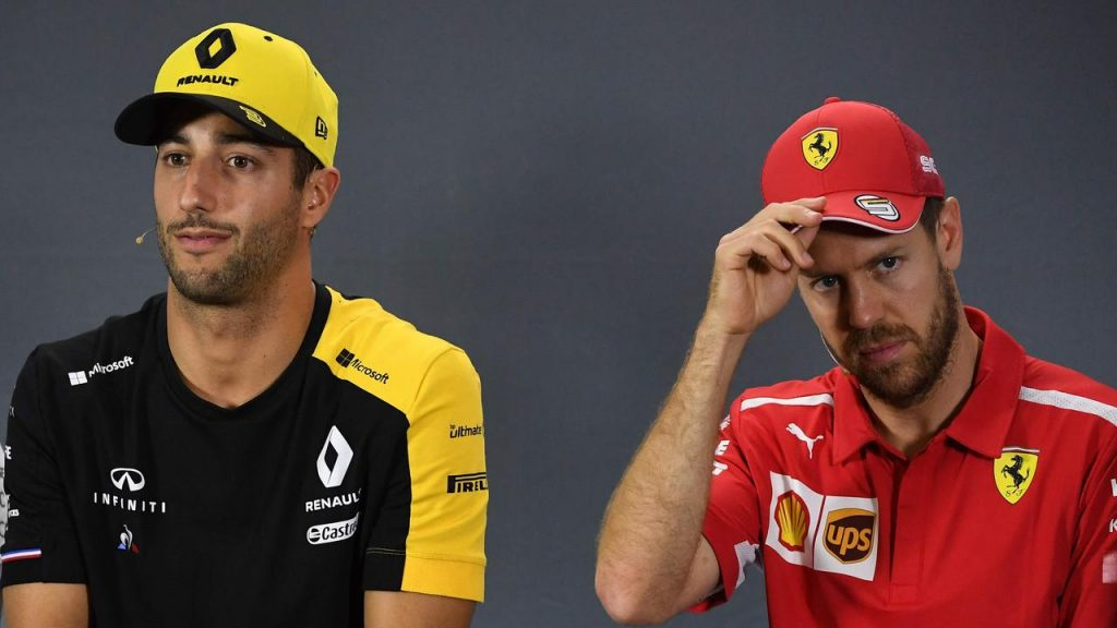 Daniel Ricciardo and Sebastian Vettel went in different directions in 2014. (Photo by William WEST / AFP)