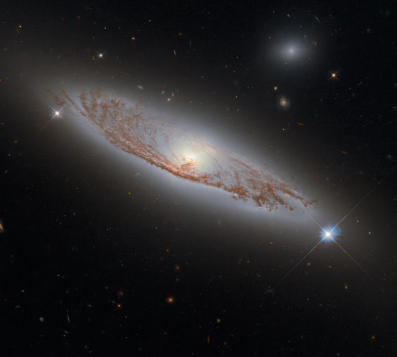This Hubble image shows NGC 5037, a spiral galaxy some 91 million light-years away in the constellation of Virgo. Image credit: NASA / ESA / Hubble / D. Rosario / L. Shatz.